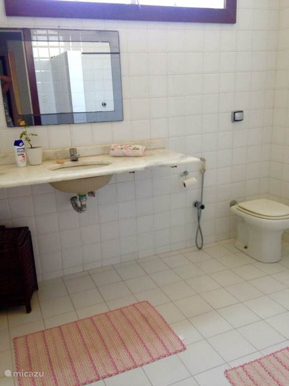 On the first floor is a second and third bathroom located. This bathroom belongs to the bedroom which is described in the previous photo.