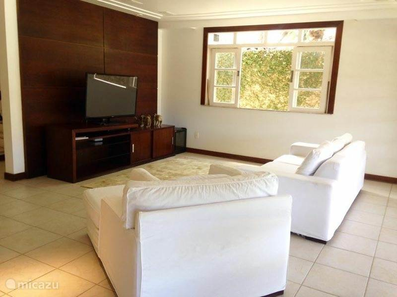 The large living room (52 ??inches) with comfortable furniture and a large flat screen television. From the living room you also have a nice view of the veranda, garden and pool.