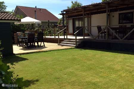 Vakantiehuis Nederland, Zeeland, Stavenisse chalet Odyssee, chalet met een goed doel