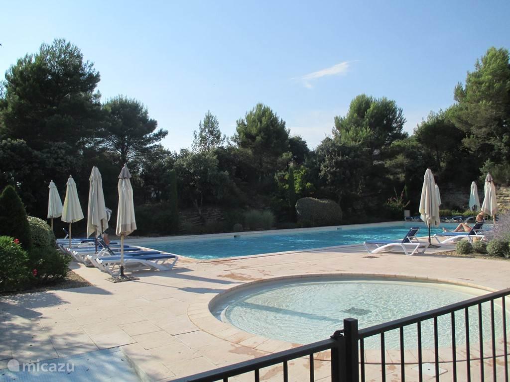 Communal swimming pool with paddling pool.