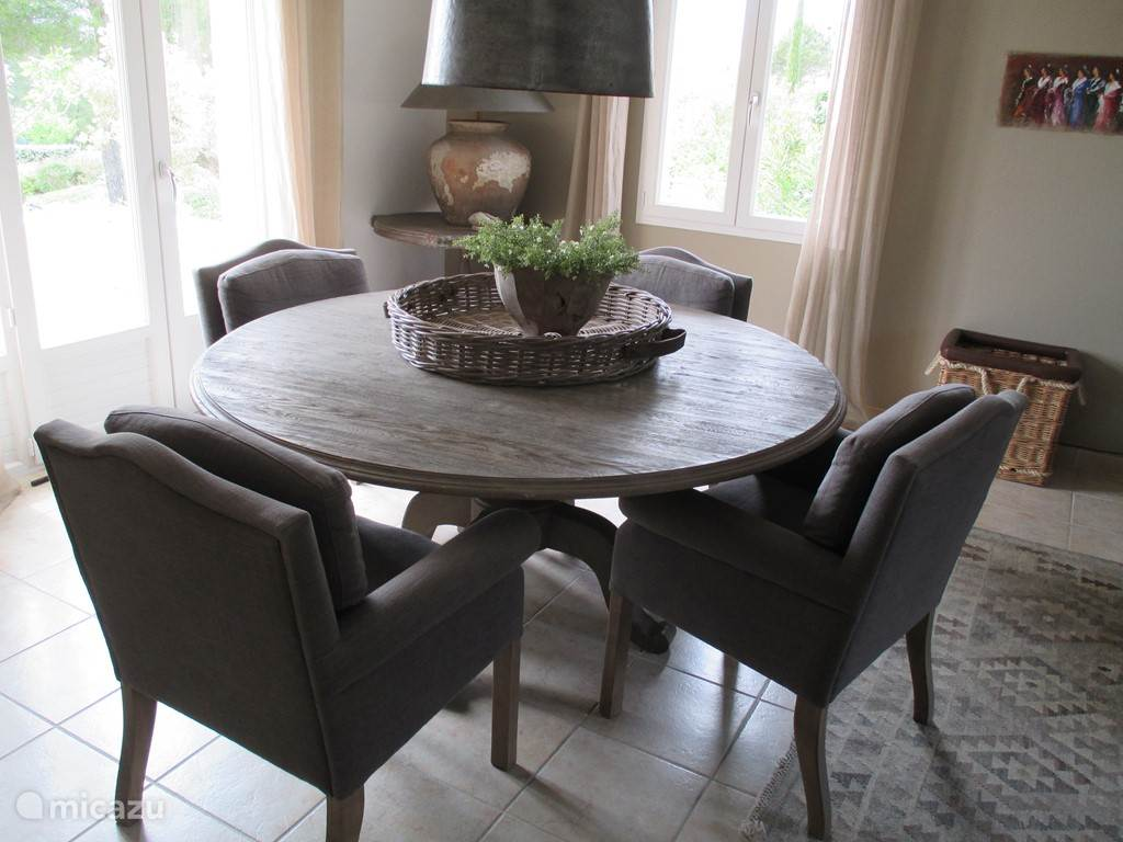 Large, round dining table.