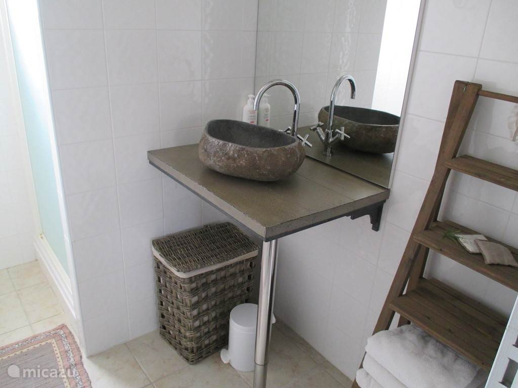 2 bathroom with one sink and shower.