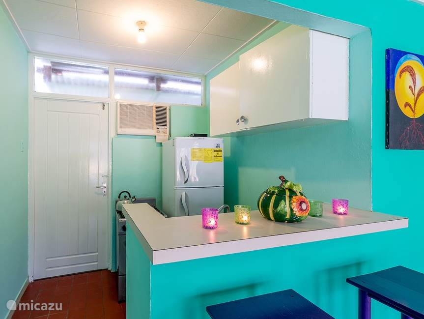 Bar and kitchen. The kitchenette, is equipped with a large fridge-freezer, a 4 burner stove with oven, a kettle for the stove, kitchen linen, crockery, cutlery, pans and all the necessary cooking utensils.