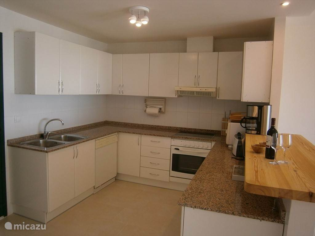 Spacious fully equipped open-plan kitchen