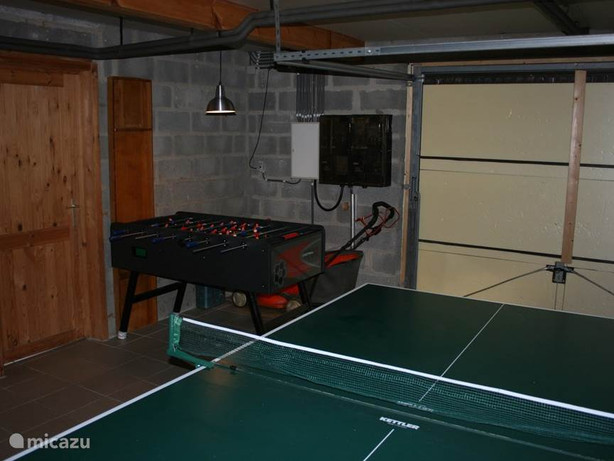 table tennis and table football in the garage