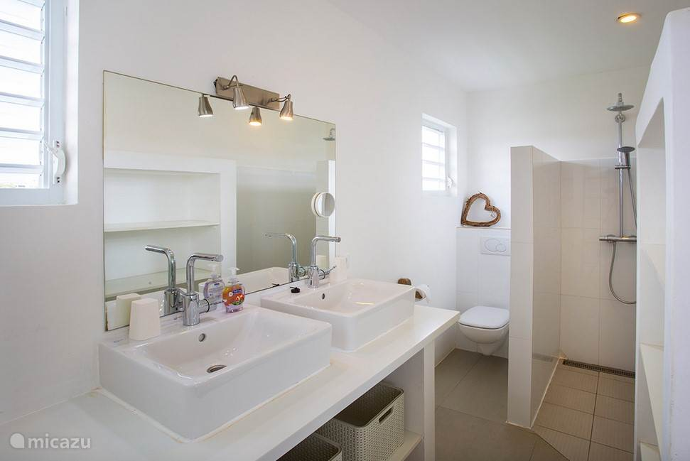 Both master bedrooms have spacious bathrooms