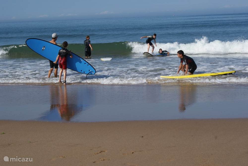 Surfing lessons at Veillon beach.