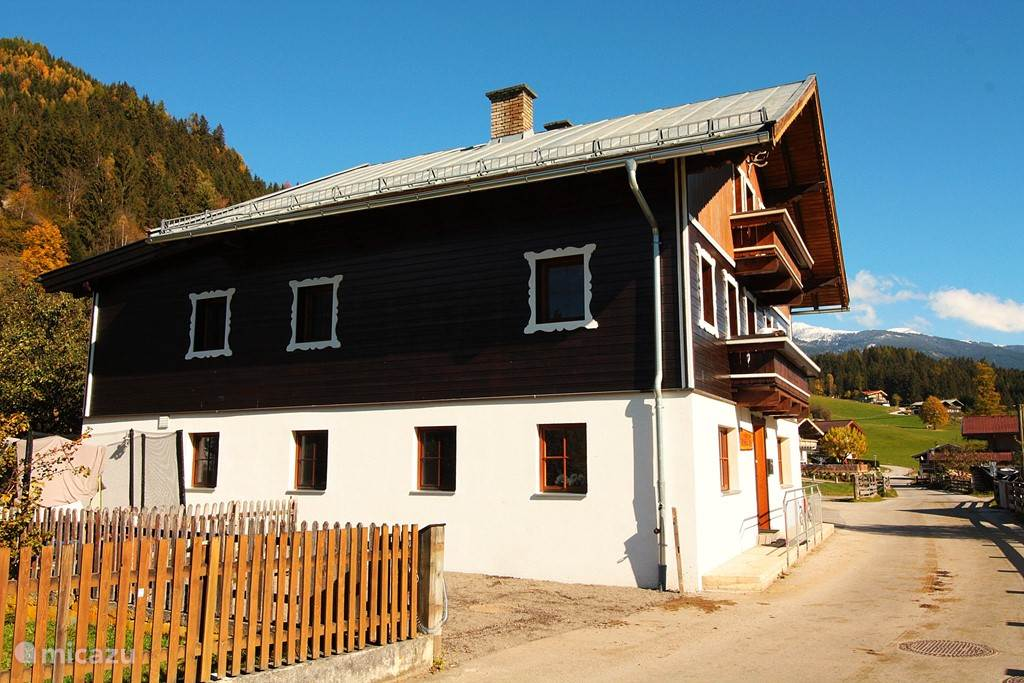 **** Wellness Haus Kitzbühel Alps side with one of the three parking spaces