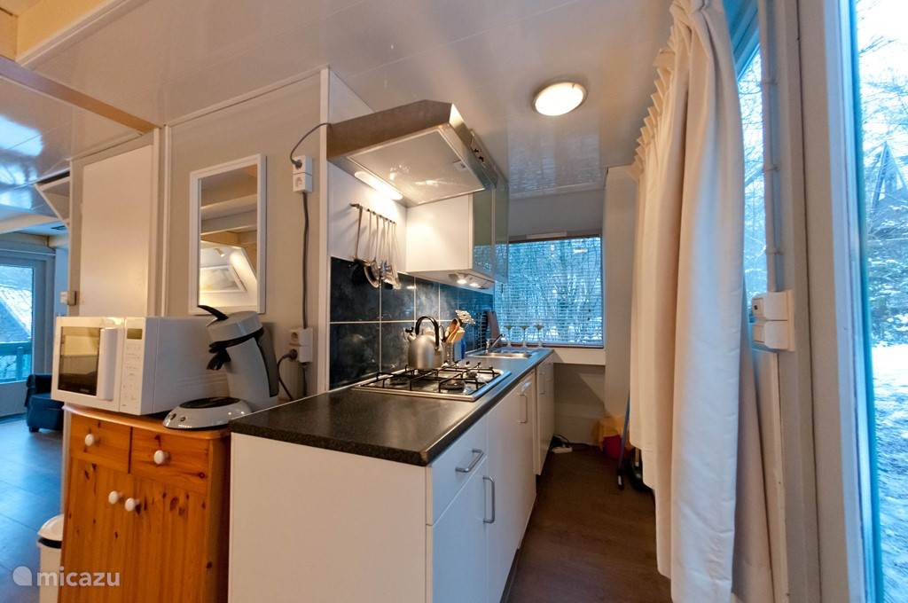 Newly remodeled kitchen with all modern comforts such as a dishwasher, microwave and Senseo.
