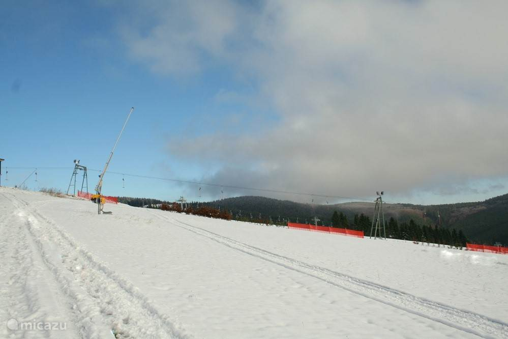 The ski slope, located directly next to the complex.