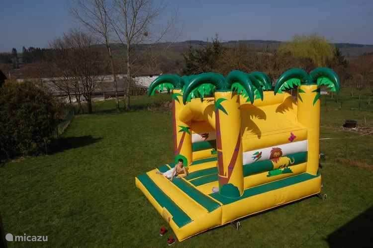 A rented inflatable in the garden as a surprise for the little ones
