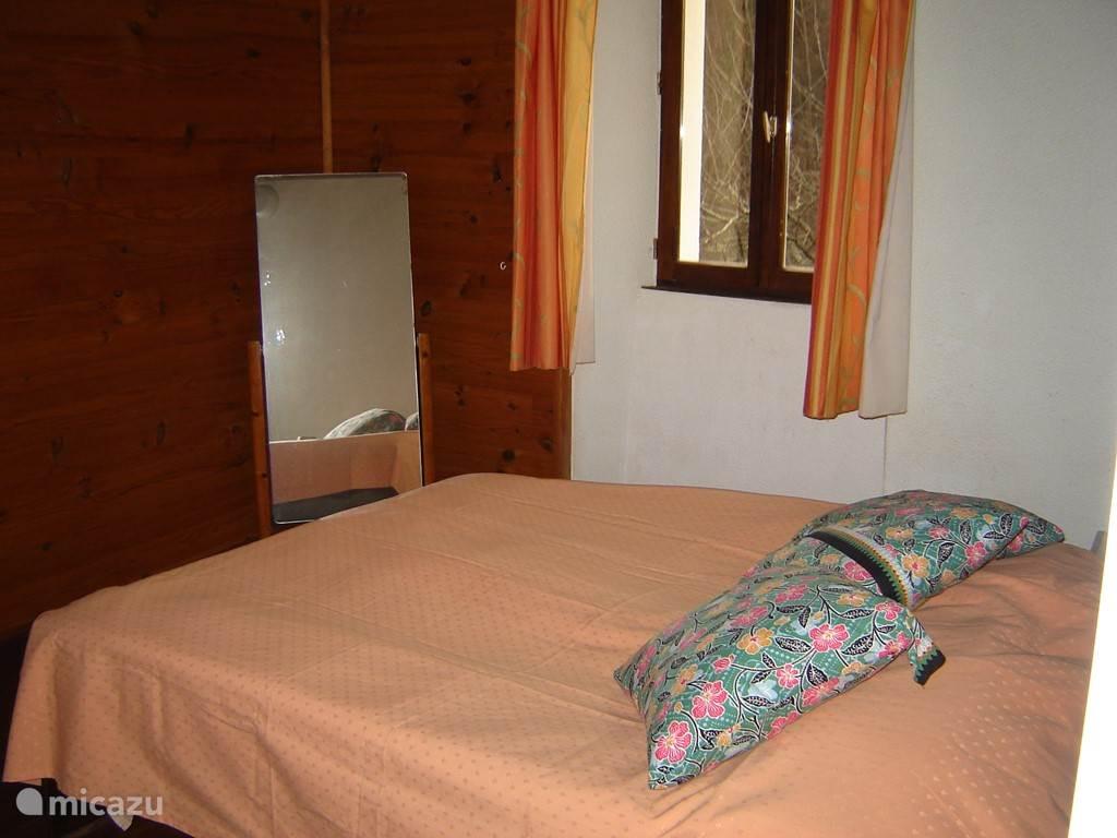Uw slaapkamer met grote spiegel