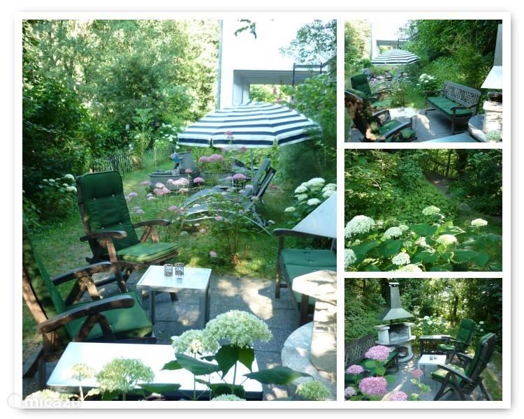 Het terrasje met BBQ cq buitenhaard.