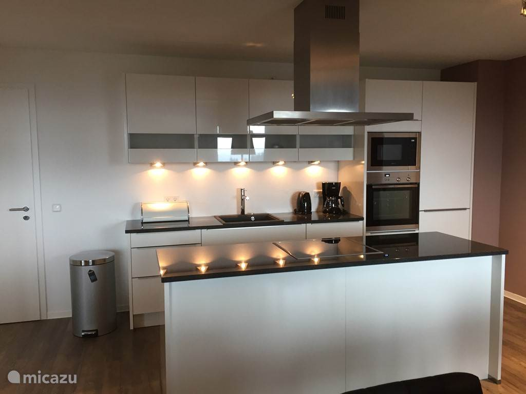 Fully fitted luxury kitchen. Washer and dryer are located in one of the storerooms in the apartment