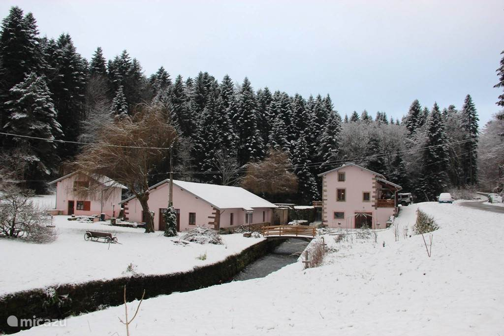 La Reine de l'eau (left) in winter. In the middle of the barn, right our house. The garden is a stream
