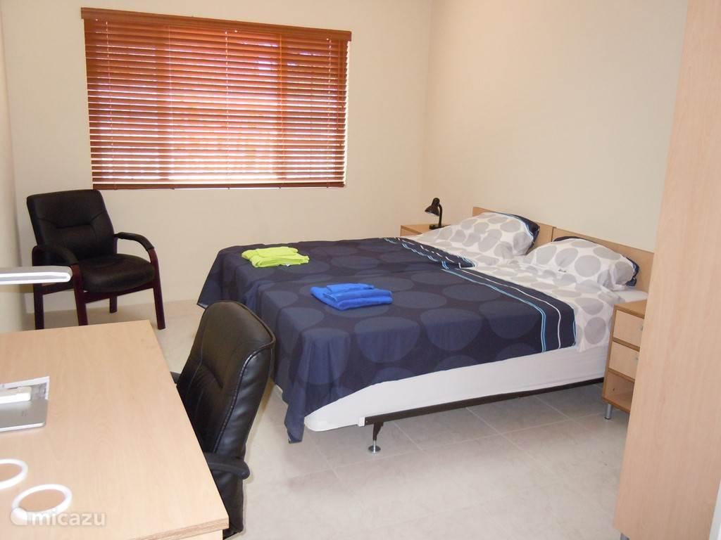 Een indruk van een slaapkamer op de bovenverdieping