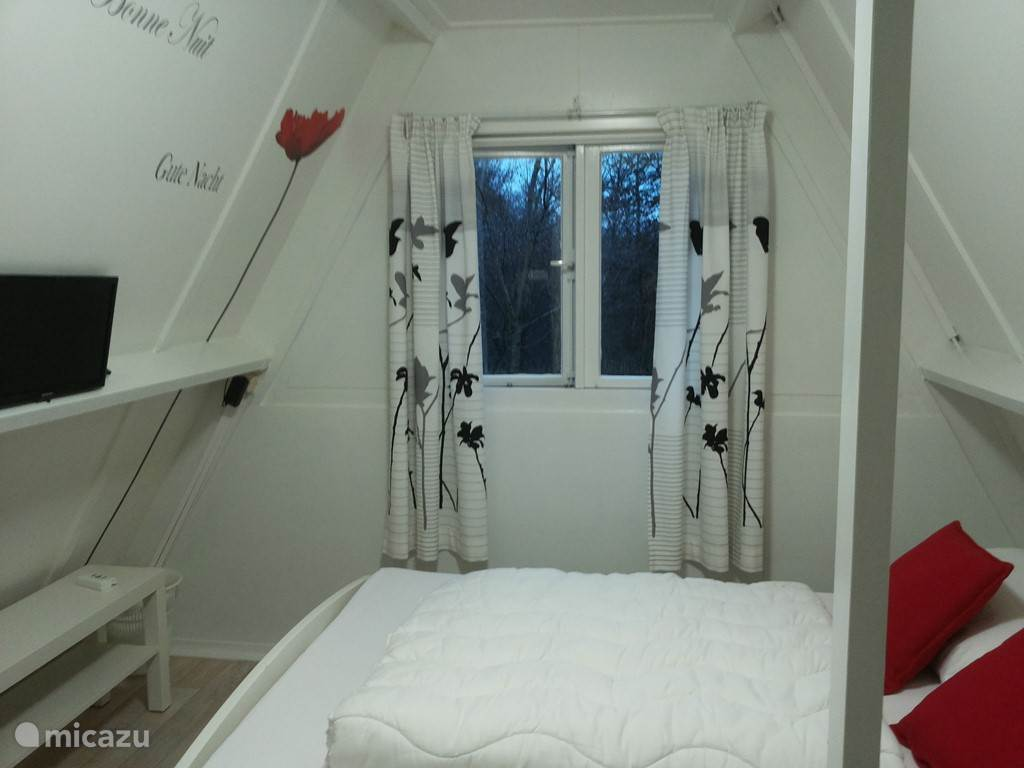 open bedroom with double bed