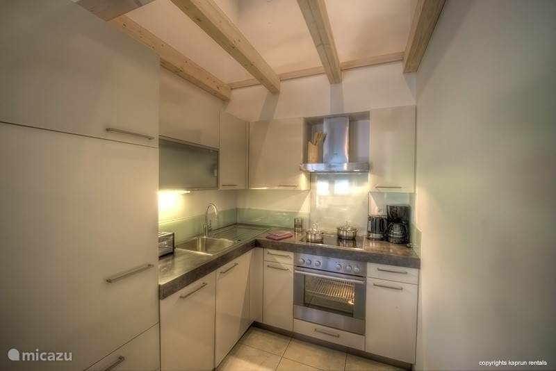 A kitchen of high quality for the discerning cook and a large fridge that can be filled to your heart's content.