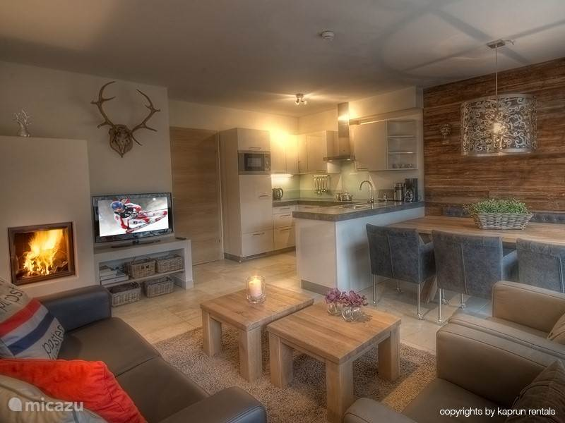 Enjoy the living room with fireplace, lovely sitting area, dining area and open kitchen.