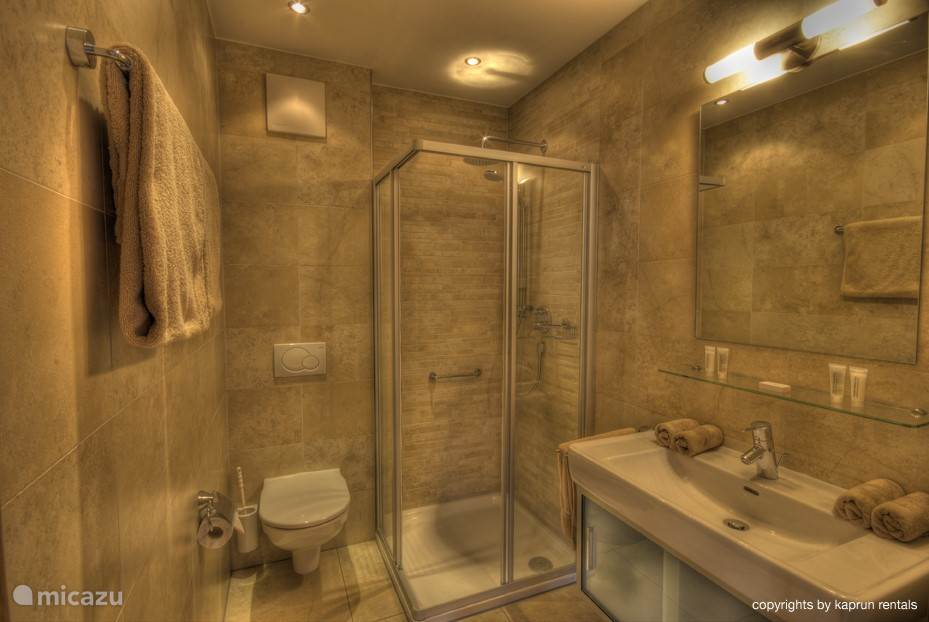 There are two luxurious bathrooms; one with bath, the other with shower
