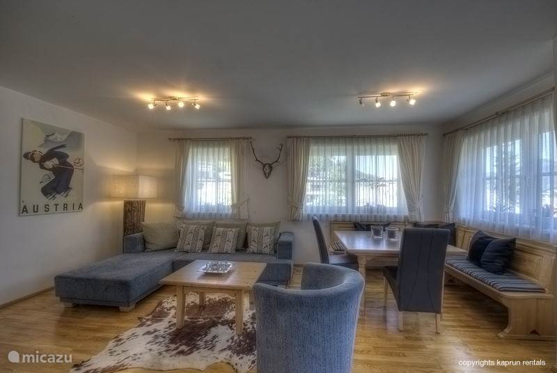 From the spacious corridor you enter the cosy and roomy living room with its large lounge couch and a typical austrian dining corner. There is a open kitchen with all equipment needed to make your stay as comfortable as possible.