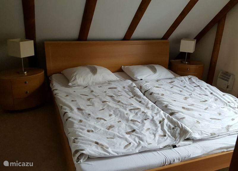 Bedroom 3: double bed, patio door to balcony and sink.