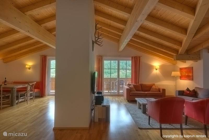 The living room is designer decorated and has a spacious seating area. It is an excellent place to relax after a wonderful day in the mountains. The dining area seats 8 people and there is a fully equiped kitchen.