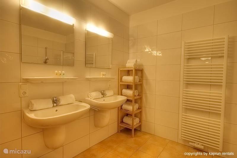 There are three bedrooms which are all very spacious with high ceilings, lots of closet space and each has its own TV. The master bedroom has a private bathroom with double sinks and a bathtub. There is also a second bathroom and separate toilet.