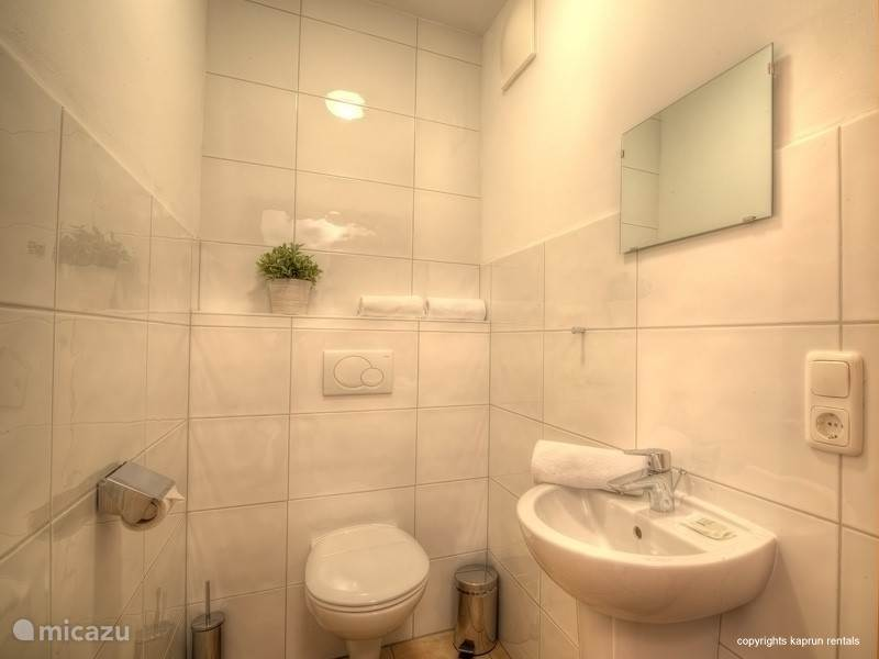 The apartment has two beautiful, spacious, comfortably decorated bedrooms with large closets and they both have a television. There is one large bathroom with a sinks and a bath tub with sower, the toilet is separate.