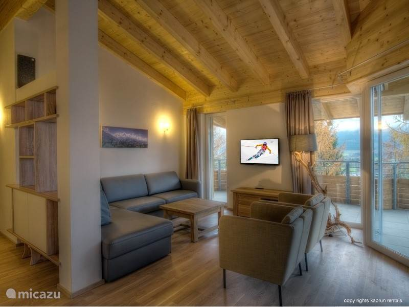 The apartment is furnished to a high quality standard and fully equipped. You will immediately feel like coming home. The high ceilings with wooden beams give the ultimate feeling of a penthouse and it's all completed by the living room with fireplace, the spacious seating area and a luxury kitchen.