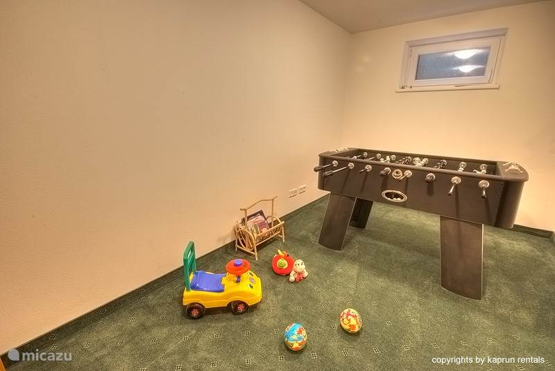 This Chalet Apartment has a children's playroom, a skiruim and a laundry room with washer and dryer.