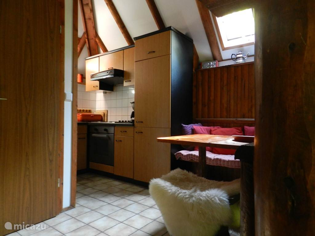 The kitchen with an extra seat