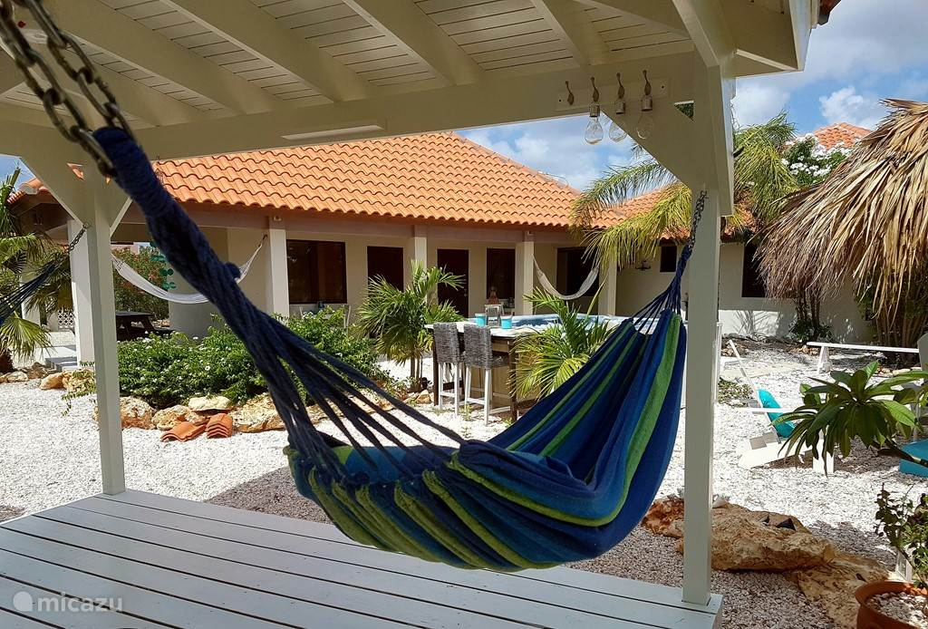 In the 500m2 garden is a gazebo where you can lay in the 2 hammocks or relax in the beach chairs