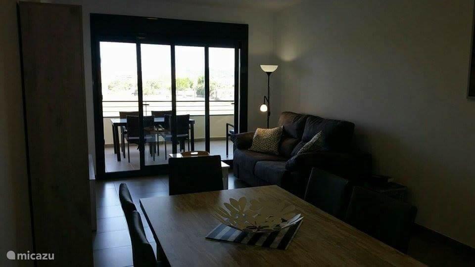 Living en eetkamer met sofabed