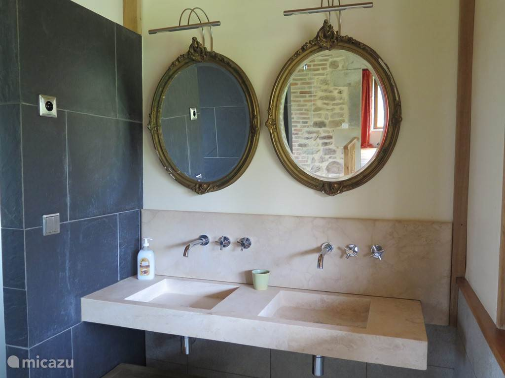 natural stone sink and shower combined with antique mirrors