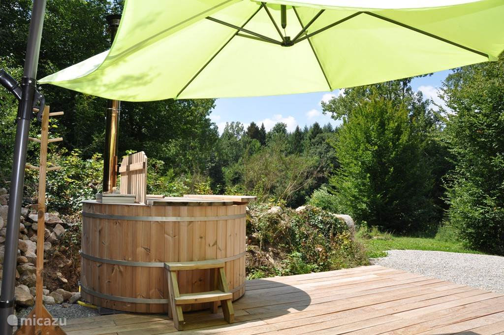 spacious woodburning hot tub