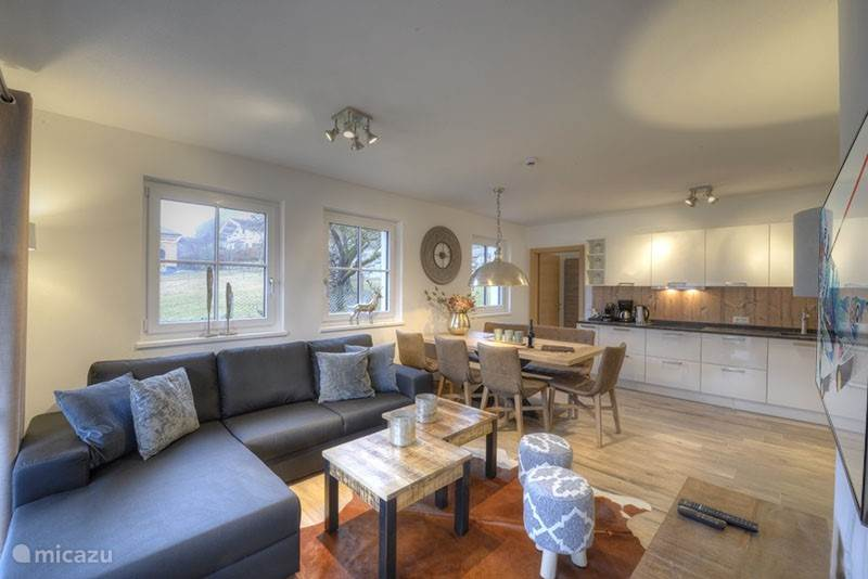 The spacious living room, with beautiful views, lots of light!