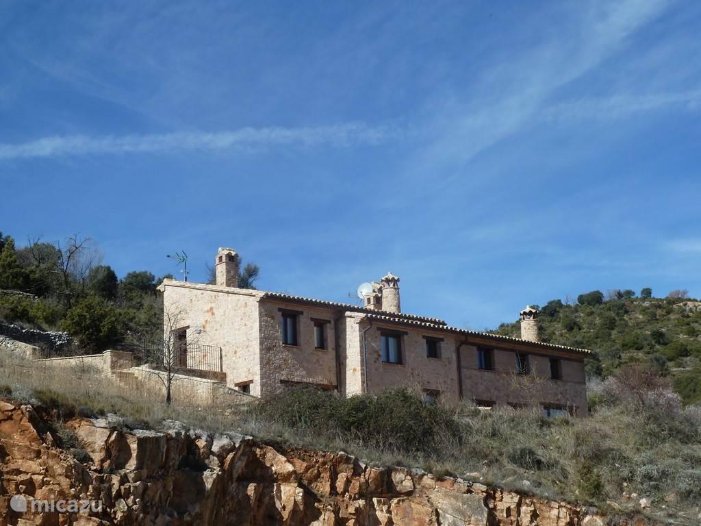 het huis en haar omgeving
