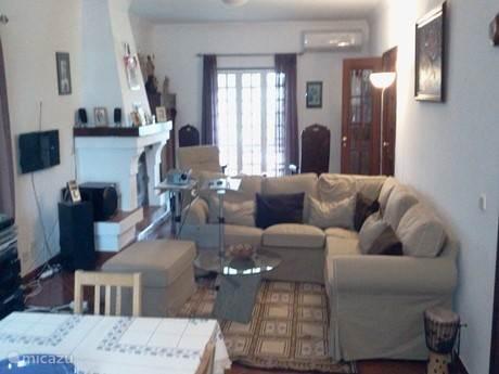 Woonkamer van 60 m² met eetruimte, salon en zithoek