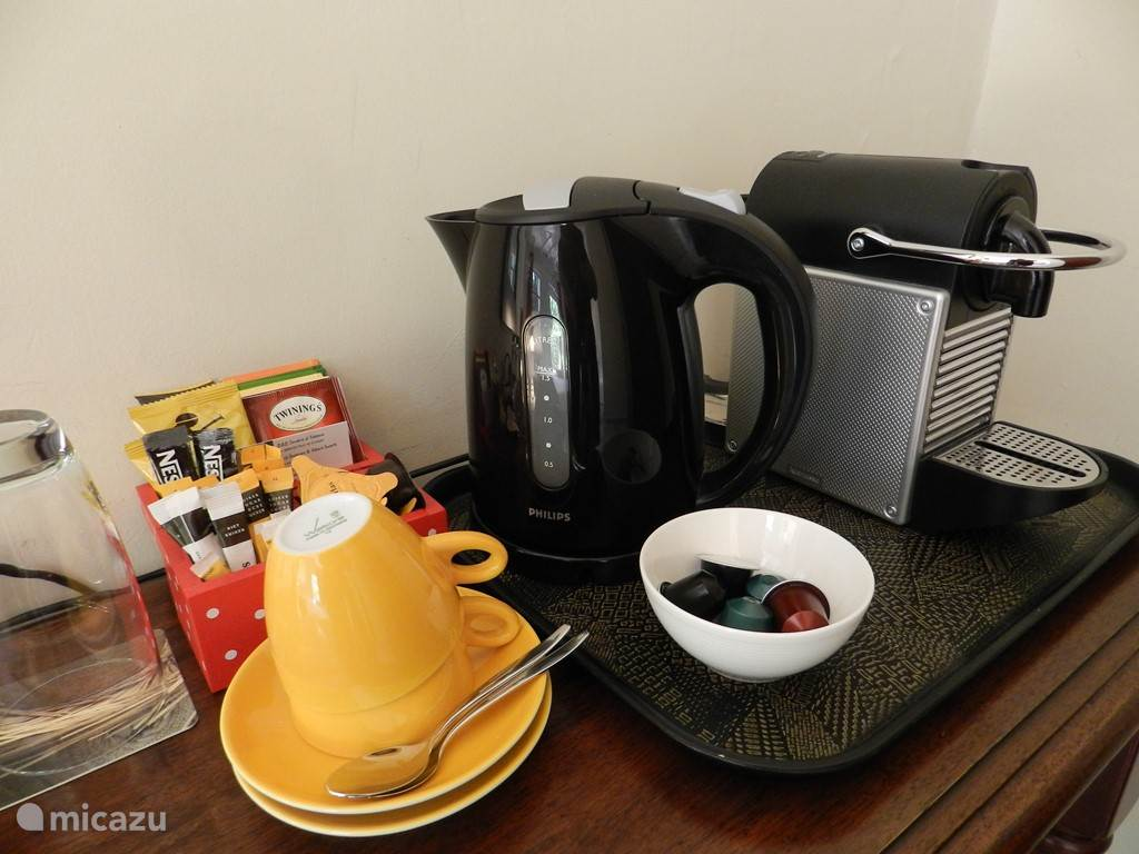 Nespresso machine, waterkettle and fridge in every room, including coffee, tea and biscuits.