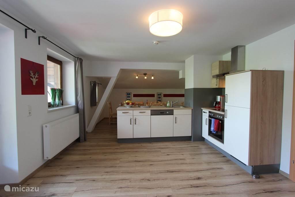 Zeer ruime leefruimte in het penthouse