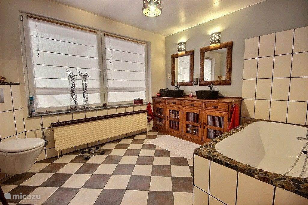 Good size bathroom with bath and walk-in shower
