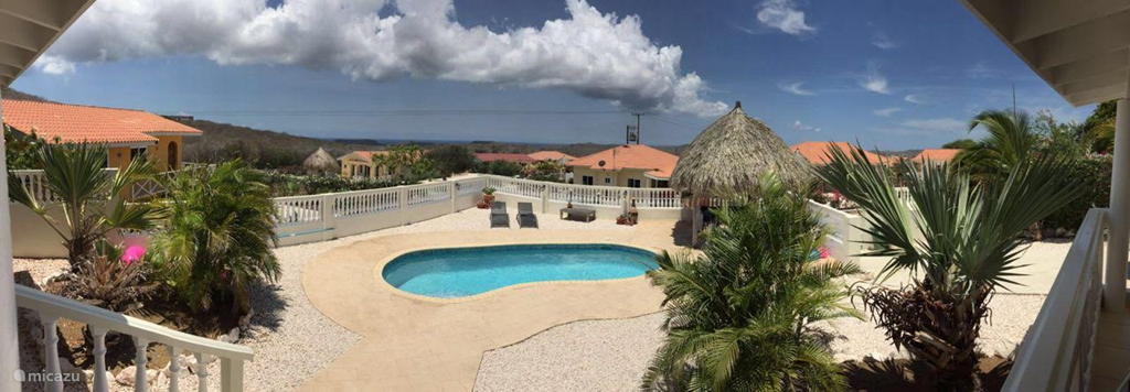the stunning view of the Caribbean sea from the porch during your tropical vacation