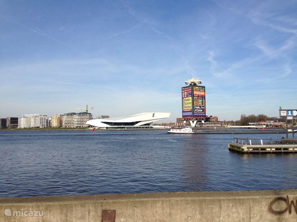 View on the harbor of Amsterdam behind Central Station