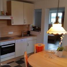 Fully equipped kitchen with cozy dining area
