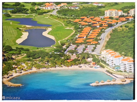 Overview of Blue Bay Village overlooking the golf course and the beach.