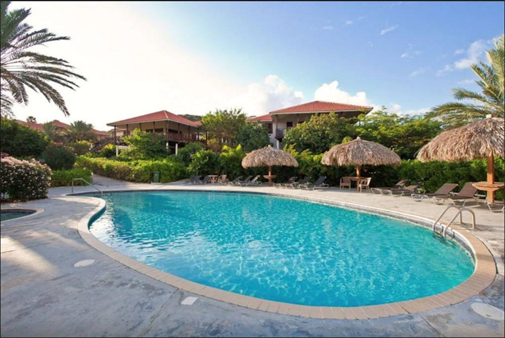 VAN 18 TOT 30 MEI - verblijf van een week in onze Villa direct aan het strand van Blue Bay voor Eur 945,-!