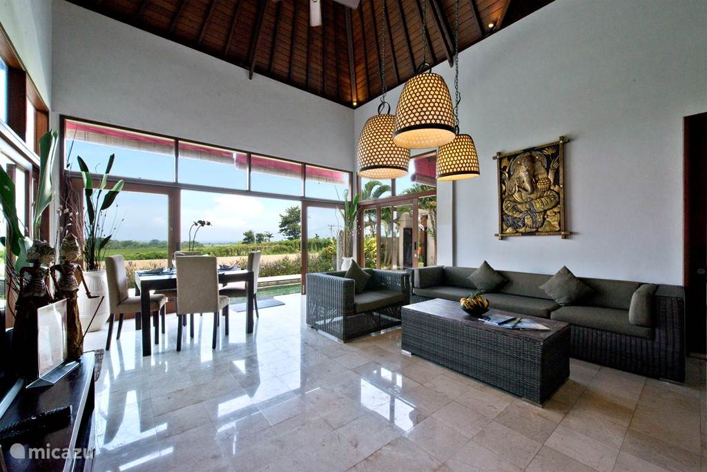 The living room of the Sahaja villa with an open kitchen with all appliances.