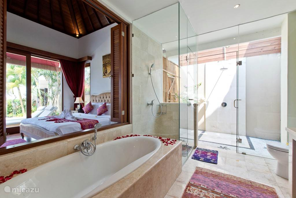 And from the spacious bathroom overlooking the bedroom .... and each bathroom has an outdoor shower .....