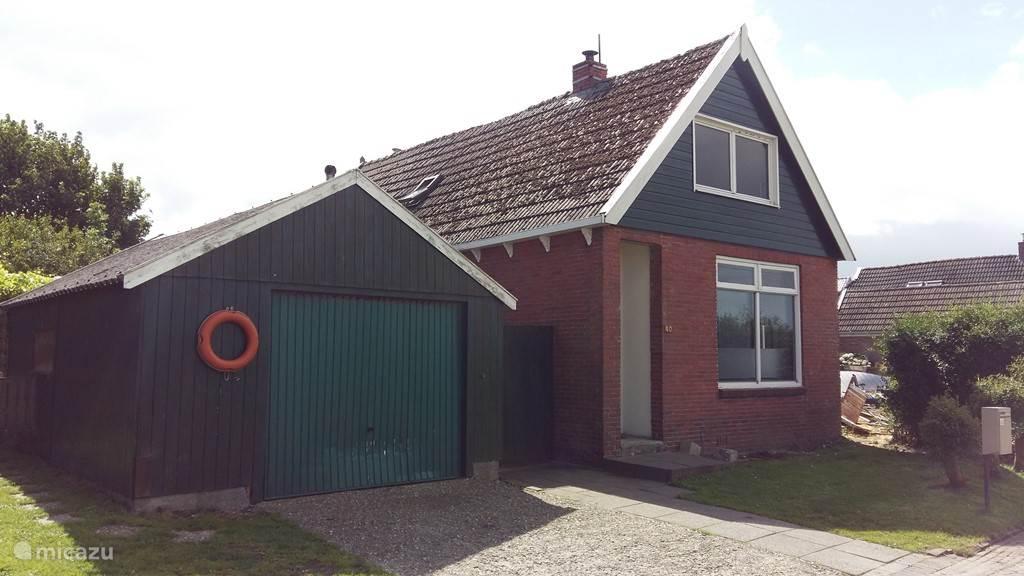 Vakantiehuis Nederland, Friesland, Holwerd - vakantiehuis Ouderwets Vissershuisje a/d Zeedijk